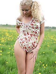 It looks like tender wind and beautiful view on the nature make blonde teen hot as she starts removing clothes.