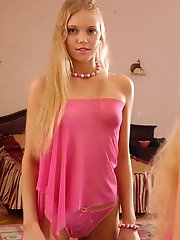 Adorable blonde teen stripping in her bedroom and watching her small breasts in the mirror
