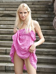 Attractive teenie with long blond hair flaunts her tight nude body with small perky tits.