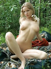 Blonde with a hot body showing her nice looking body in the forest and in the lake